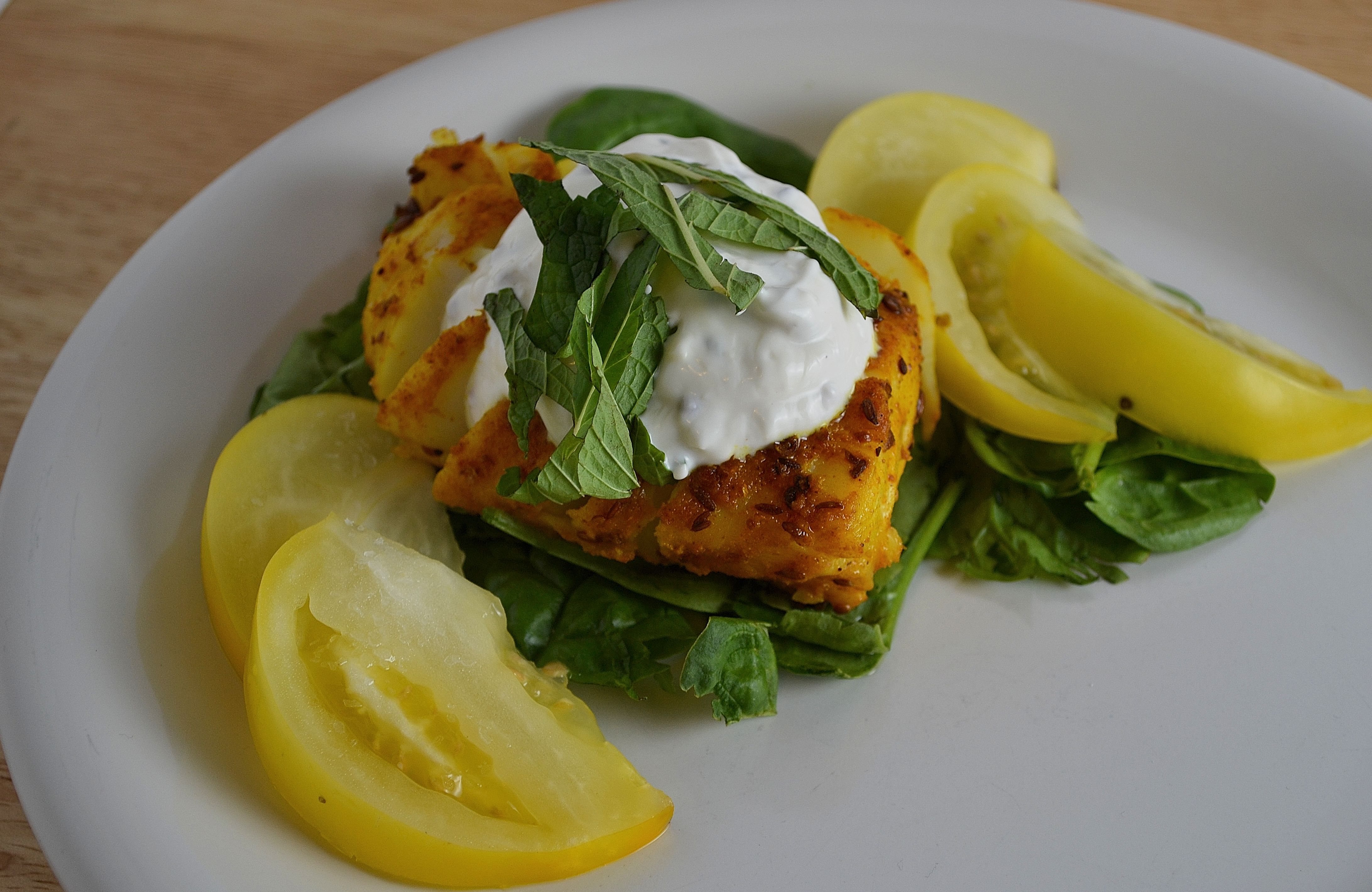 Grilled cod with indian spices and yellow tomatoes the for Grilled cod fish recipes